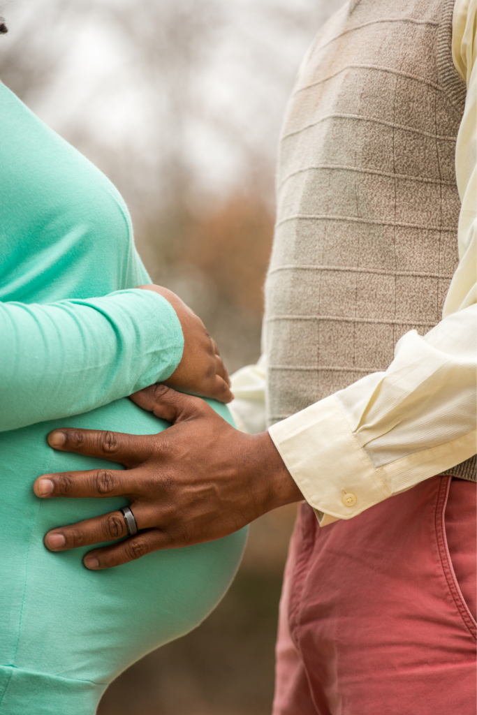 black pregnant woman and her husband